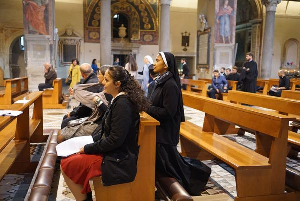 People praying at the Pontifical Oriental Institute